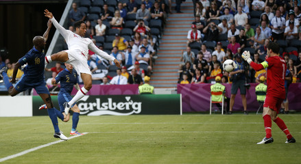 England's Lescott scores against France during their Group D Euro 2012 soccer match in Donetsk