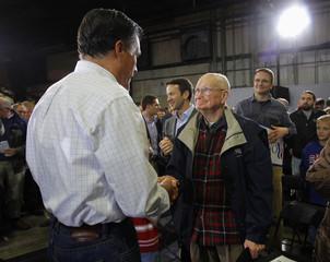 U.S. Republican presidential candidate and former Massachusetts Governor Mitt Romney greets an audience member at a campaign stop at Centro Incorporated in North Liberty