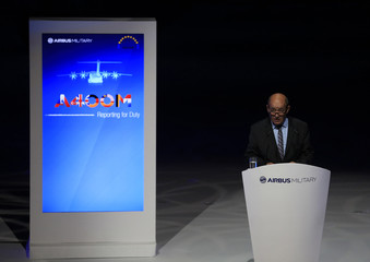 France's Defence Minister Le Drian gives speech during unveiling ceremony of the Airbus A400M military transport plane at an assembly plant in the Andalusian capital of Seville
