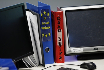 Files sit on a desk at the Joint Operations Centre and Maritime Security Centre Horn of Africa during a media briefing at the EU NAVFOR Operations Headquarters at Northwood in north west London