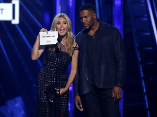 Presenters Klum and Strahan announce that The Weeknd is the winner for Top Hot 100 Artist at the 2016 Billboard Awards in Las Vegas