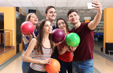 Friends taking selfie at bowling club
