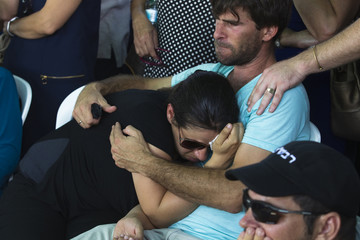 Gila and Doron, the parents of four-year-old Israeli boy Daniel Tregerman, mourn during his funeral near the border with the Gaza Strip