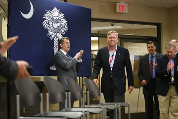 Bush is applauded as he arrives for a town hall meeting with employees at FN America gun manufacturers in Columbia, South Carolina