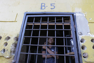 An inmate poses for a picture inside his cell at a jail where crew members of Florida-based shipwreck salvage company Aqua Quest International have been detained, in Puerto Lempira