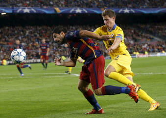 Barcelona's Suarez fights for the ball against Bate Borisov Haiduchyk during their Champions League soccer match at Camp Nou stadium in Barcelona