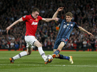 Manchester United's Jones fights for the ball with Bayern Munich's Mueller during their Champions League quarter-final first leg soccer match at Old Trafford in Manchester