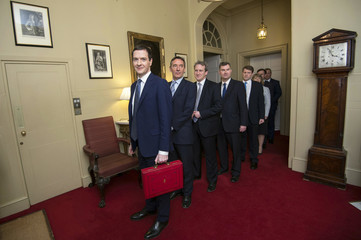 Britain's Chancellor of the Exchequer Osborne leads his Treasury team as they prepare to leave number 11 Downing Street before presenting the Budget in London