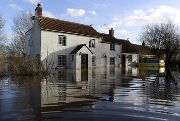 A flooded house is seen in urban landscape taken in the flooded Somerset village of Moorland