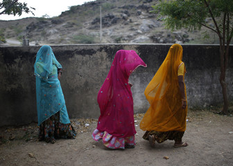 Women leave a polling station after casting their votes in Ajmer district