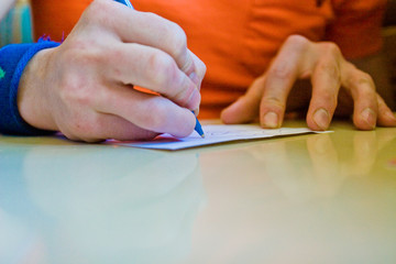 Hands Writing A Letter