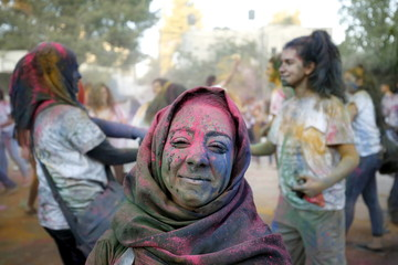 Palestinian reveller takes part in a colours festival organized by Palestinian activists in the West Bank city of Ramallah