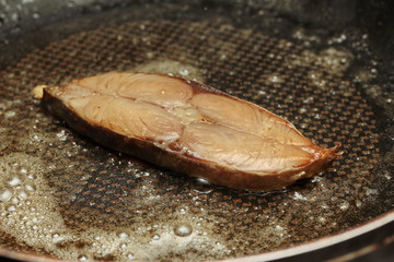 Deep-fried dried salted sea fish,Spotted mackerels in pan.