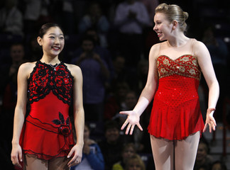 Rachael Flatt and Mirai Nagasu celebrate on the podium after placing first and second respectively in the ladies championship skate at the U.S. Figure Skating Championships in Spokane