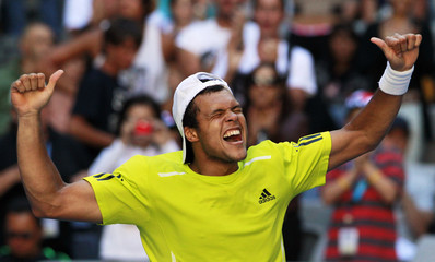 Jo-Wilfried Tsonga of France reacts after defeating Ukraine's Sergiy Stakhovsky during the Australian Open tennis tournament in Melbourne