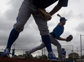 Toronto Blue Jays pitchers throw from the practice mound under stormy skies at the team's MLB baseball spring training facility in Dunedin