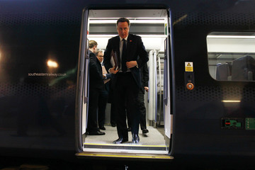 Britain's Prime Minister David Cameron exits a train at Stratford station to a cabinet meeting at the 2012 Olympic Games site in London
