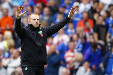 Celtic manager Neil Lennon walks onto the pitch and gestures to their fans after their Scottish Premier League Old Firm soccer match against Rangers in Glasgow, Scotland