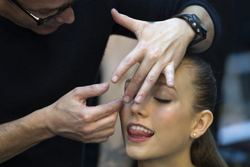 A model is made up backstage at Lebanese designer Elie Saab's Haute Couture Spring-Summer 2012 fashion show in Paris