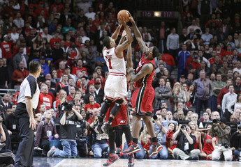 Heat's James blocks a shot from Bulls' Rose during Game 5 of their NBA Eastern Conference Finals playoff basketball game in Chicago