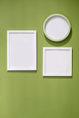 square frame and clock on green wall,interior decorate