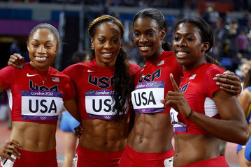 U.S. team poses for photos after they won the women's 4x400m relay final at the London 2012 Olympic Games
