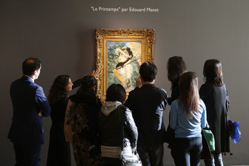 "Visitors look at the painting ""Le Printemps"" by French painter Edouard Manet during its presentation at Christie's Auction House in Paris"