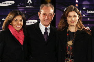 Paris Mayor Delanoe and French actress and former fashion model Casta attend the ceremony to inaugurate the Christmas holiday lights on the Champs Elysees in Paris