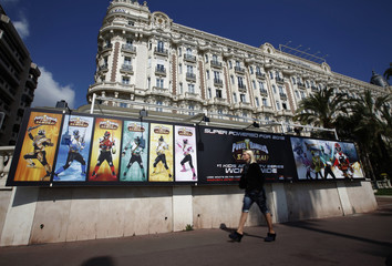 Television series advertisements are posted in front of the Carlton hotel in Croisette in Cannes