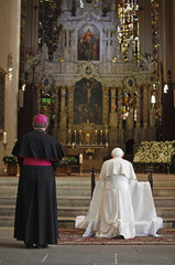 Pope Benedict XVI accompanied by Bishop Wanke as he prays in Erfurt Cathedral in Erfurt