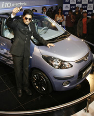 Bollywood actor Khan poses with Hyundai's i 10 electric car in New Delhi