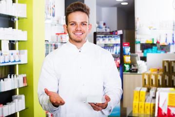 Man druggist in pharmacy