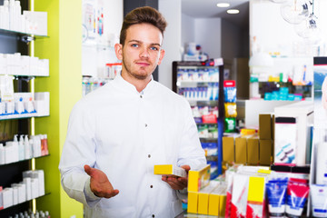 Man druggist in pharmacy