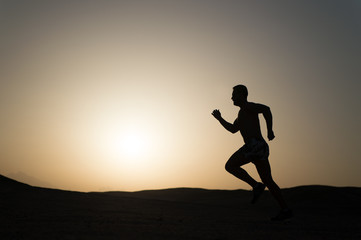 silhouette or man runner, guy running outdoor at clear sky