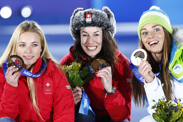 Joint gold medalists Switzerland's Gisin and Slovenia's Maze pose with bronze medalist Switzerland's Gut during the medal ceremony for the women's alpine skiing downhill race at the Sochi 2014 Winter Olympic Games in Sochi