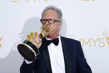 """Director Colin Bucksey poses with his Outstanding Directing for a Miniseries, Movie or Dramatic Special Award for FX Networks """"Fargo"""" at the 66th Primetime Emmy Awards in Los Angeles"""