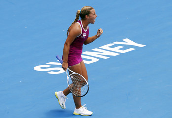 Cibulkova of Slovakia reacts after defeating Errani of Italy during their women's singles match at the Sydney International tennis tournament