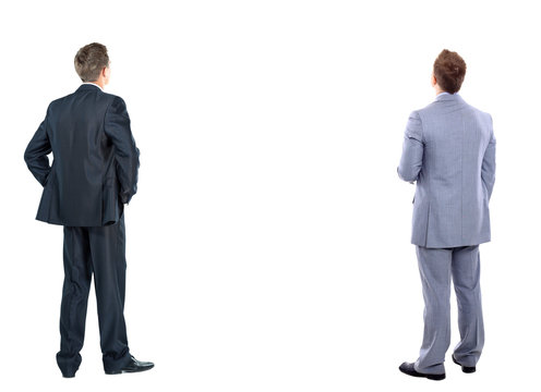 two business mans from the back - looking at something over a white background