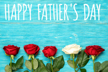 happy father's day, red and white roses on turquoise table