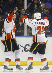 Calgary Flames Tanguay and Langkow celebrate Tanguay's goal during third period of their NHL hockey game against St. Louis Blues in St. Louis