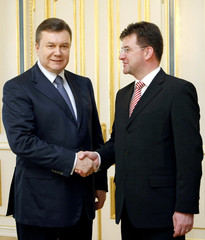 Ukraine's President Yanukovich shakes hands with Slovakia's Foreign Minister Lajcak as they meet for talks in Kiev
