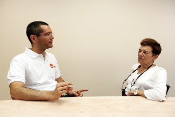 Kidron, CEO of Oramed Pharmaceuticals, oses for photo with his mother, Oramed's chief scientific officer, Miriam in Jerusalem