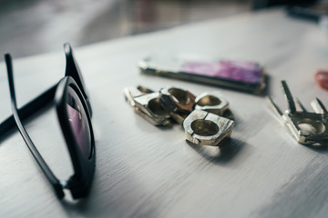 sunglasses and rings on a table