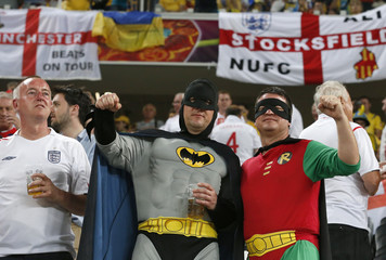 England soccer fans dressed as Batman and Robin cheer before their Group D Euro 2012 soccer match against Ukraine at the Donbass Arena in Donetsk