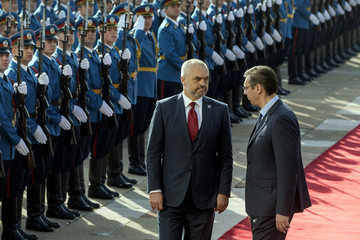Albanian Prime Minister Rama and his Serbian counterpart Vucic inspect the hounour guard during an official welcoming ceremony in Belgrade
