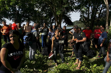Cubans Migrants stand after arriving safely in La Miel in the province of Guna Yala in Panama, having crossed the border from Colombia through the jungle