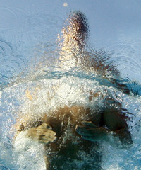 Munoz Perez of Spain is seen from underwater as he swims in the men's 50m butterfly semifinals at the European Swimming Championships in Budapest