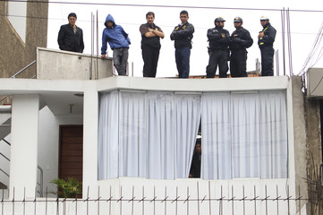 Police officers participate in the seizure of the belongings of Crespo, main lawyer of guerrilla group Shining Path leader Abimael Guzman, at his home in Lima