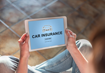 Car insurance concept on a tablet