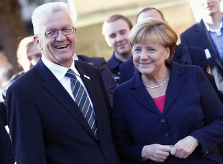 German Chancellor Merkel and Baden-Wuerttemberg's Prime Minister Kretschmann arrive for the 23rd German Unification Day festivities in Stuttgart